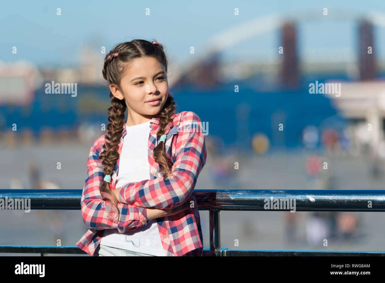 What do on holidays. Sunny day walk. Leisure options. Free time and leisure. Girl cute kid with braids relaxing urban background defocused. Organize activities for teenagers. Vacation and leisure. - Stock Image