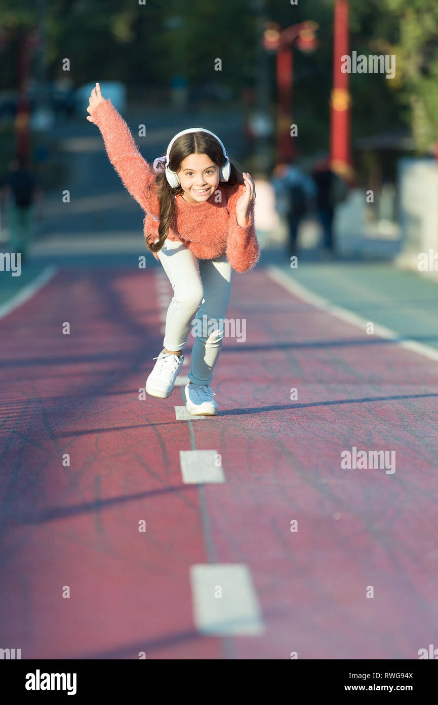Sport is our life  Getting ready to run  Little girl start running