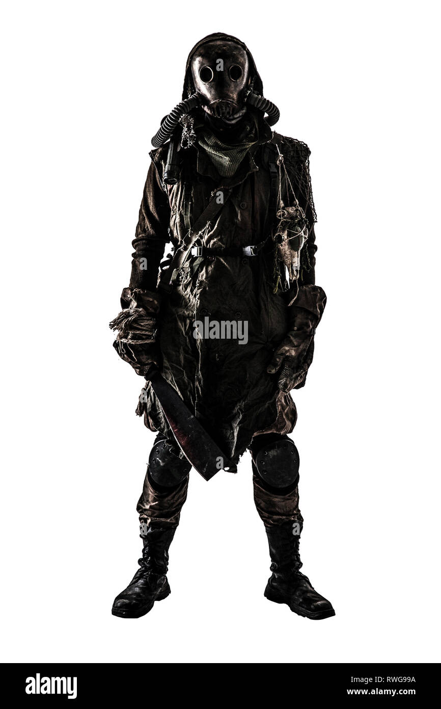 Terrifying post apocalyptic creature dressed in tattered rags and full-face gas mask. - Stock Image