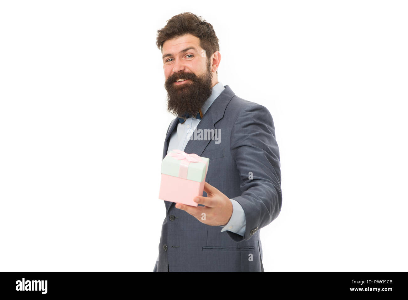 Nice present. Gift for spouse. Romantic surprise. Man formal suit hold gift box white background. Love and romantic feelings concept. Valentines day gift. Man with beard celebrate valentines day. - Stock Image