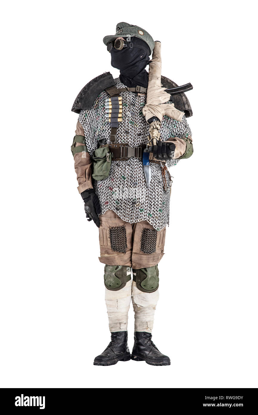 Post apocalyptic soldier wearing handmade armor, standing at attention. - Stock Image