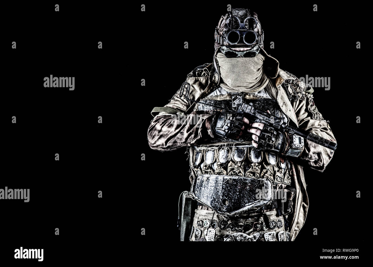 Post apocalyptic survivor wearing face mask and handmade lamellar armor. - Stock Image