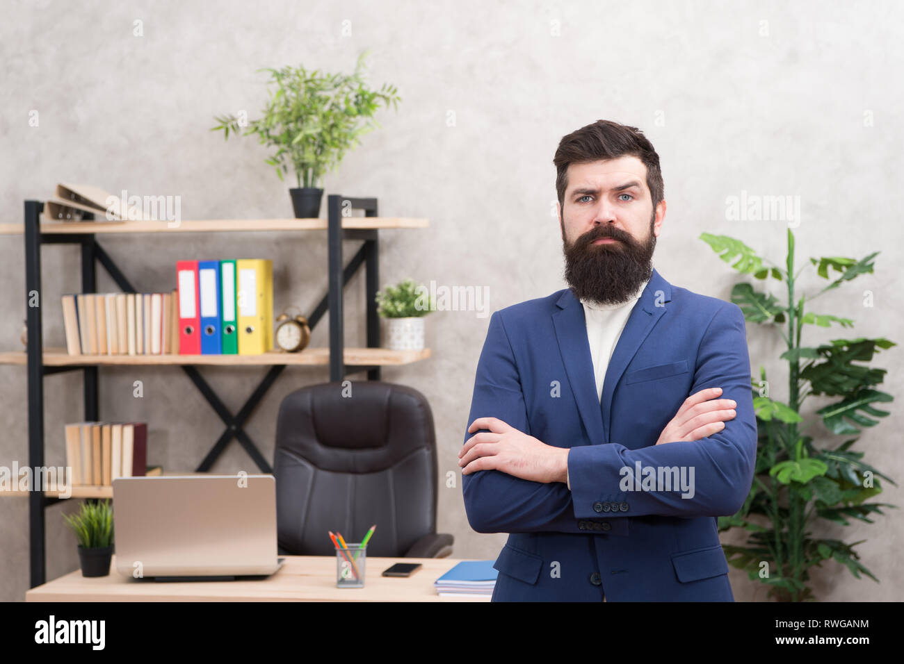 Every boss started as worker. Man bearded hipster boss looking at you with attention. Boss standing in office. Boss receive complaints. Executive director and ceo leadership titles in organizations. - Stock Image