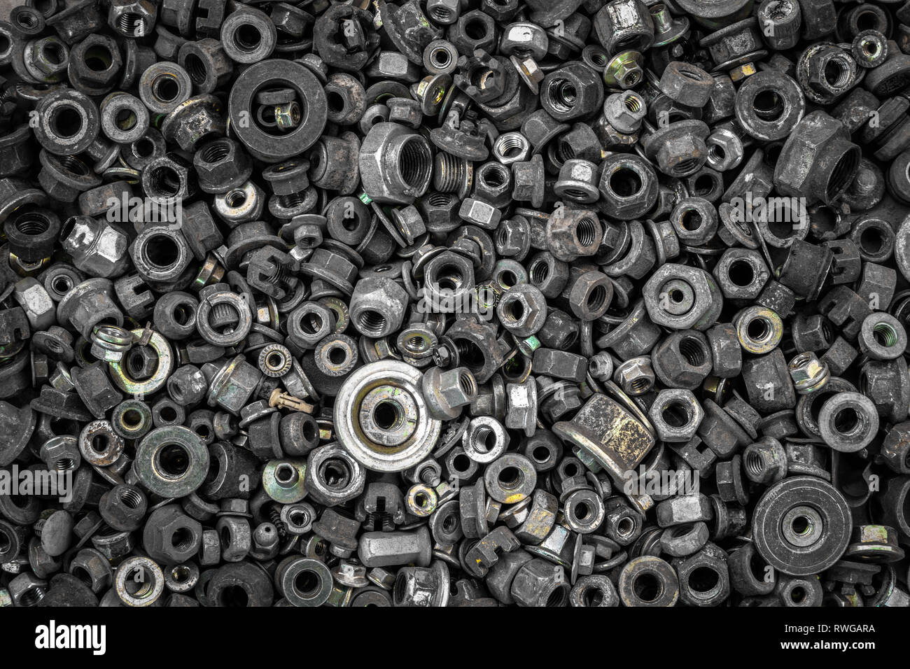 Flat Lay metal fasteners: washers, nuts, vinitiki, screws,, top view. Close-up Carpenter's Tool Kit - Stock Image