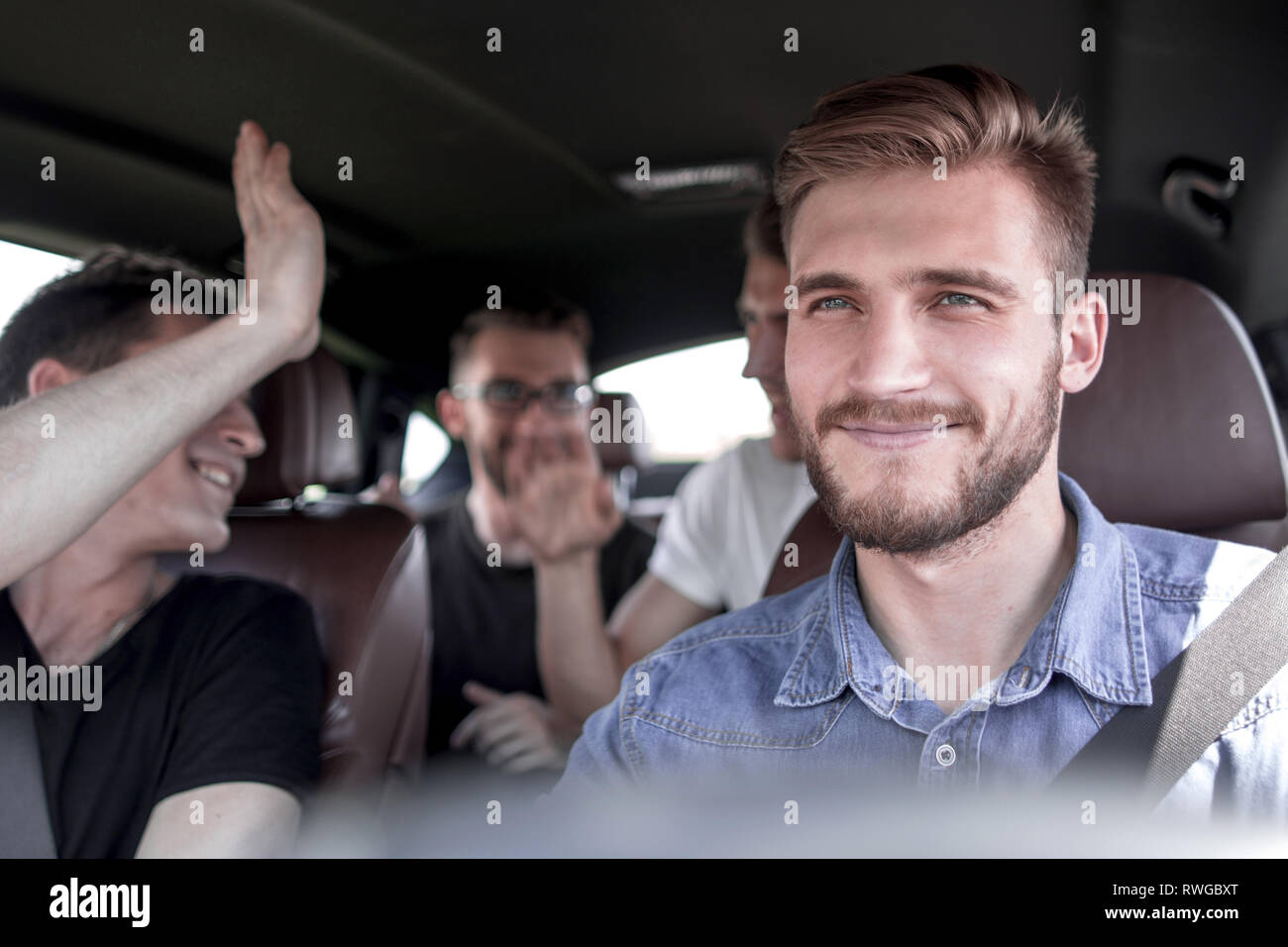 Group of happy friends on a car - Stock Image