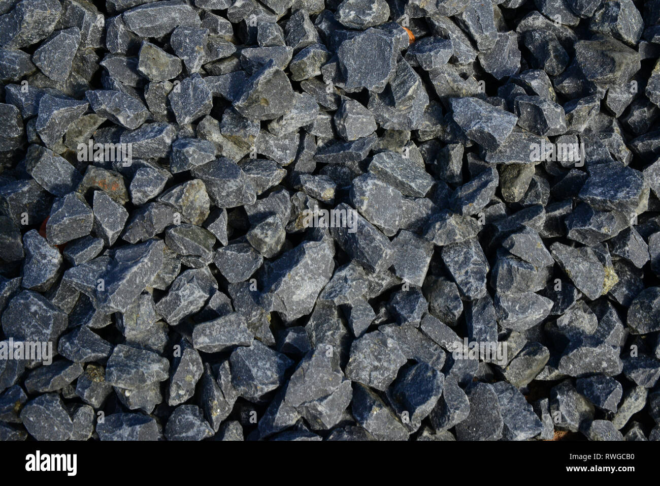 The basalt pit Bauersberg. Rhoen, Bavaria, Germany. Cracked basalt  used for construction - Stock Image