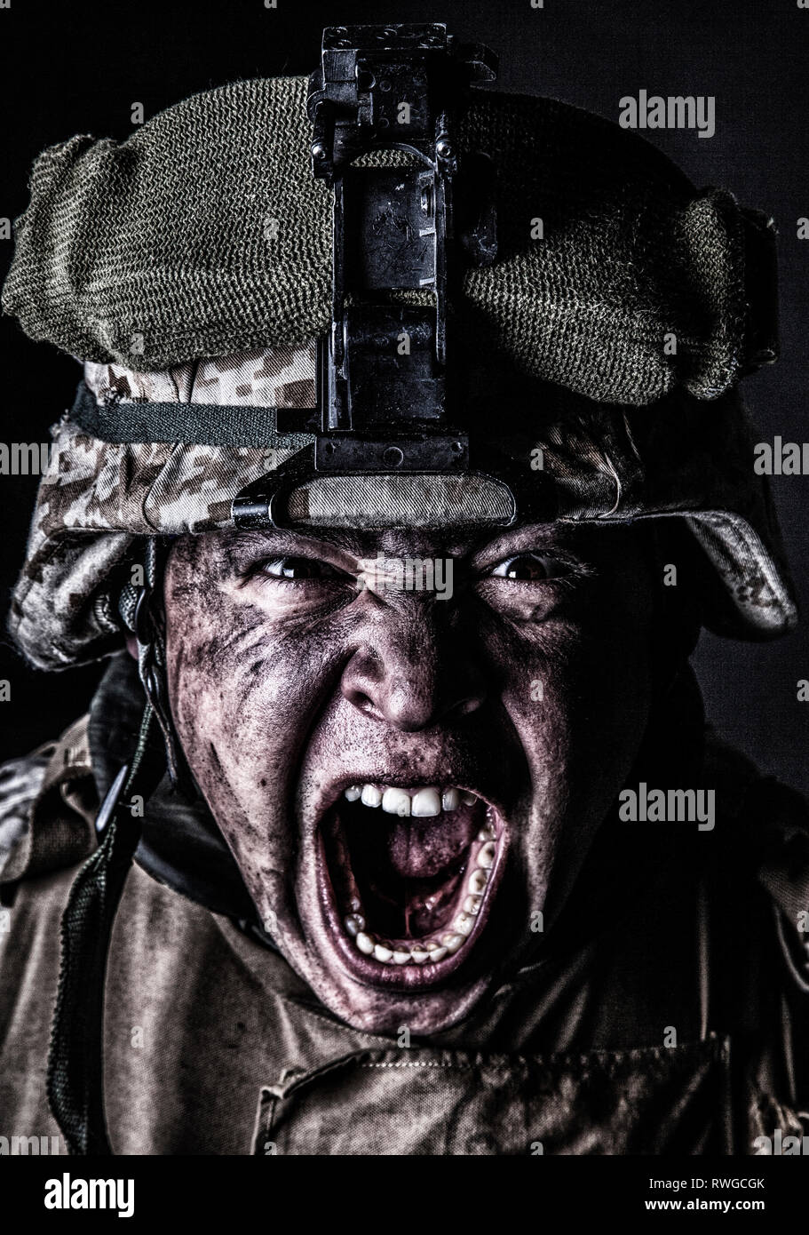 Close-up portrait of an aggressive U.S. Army soldier screaming loudly. - Stock Image