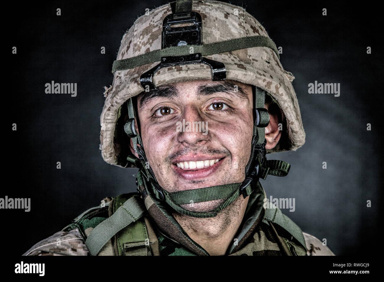 Studio portrait of a smiling U.S. soldier. - Stock Image