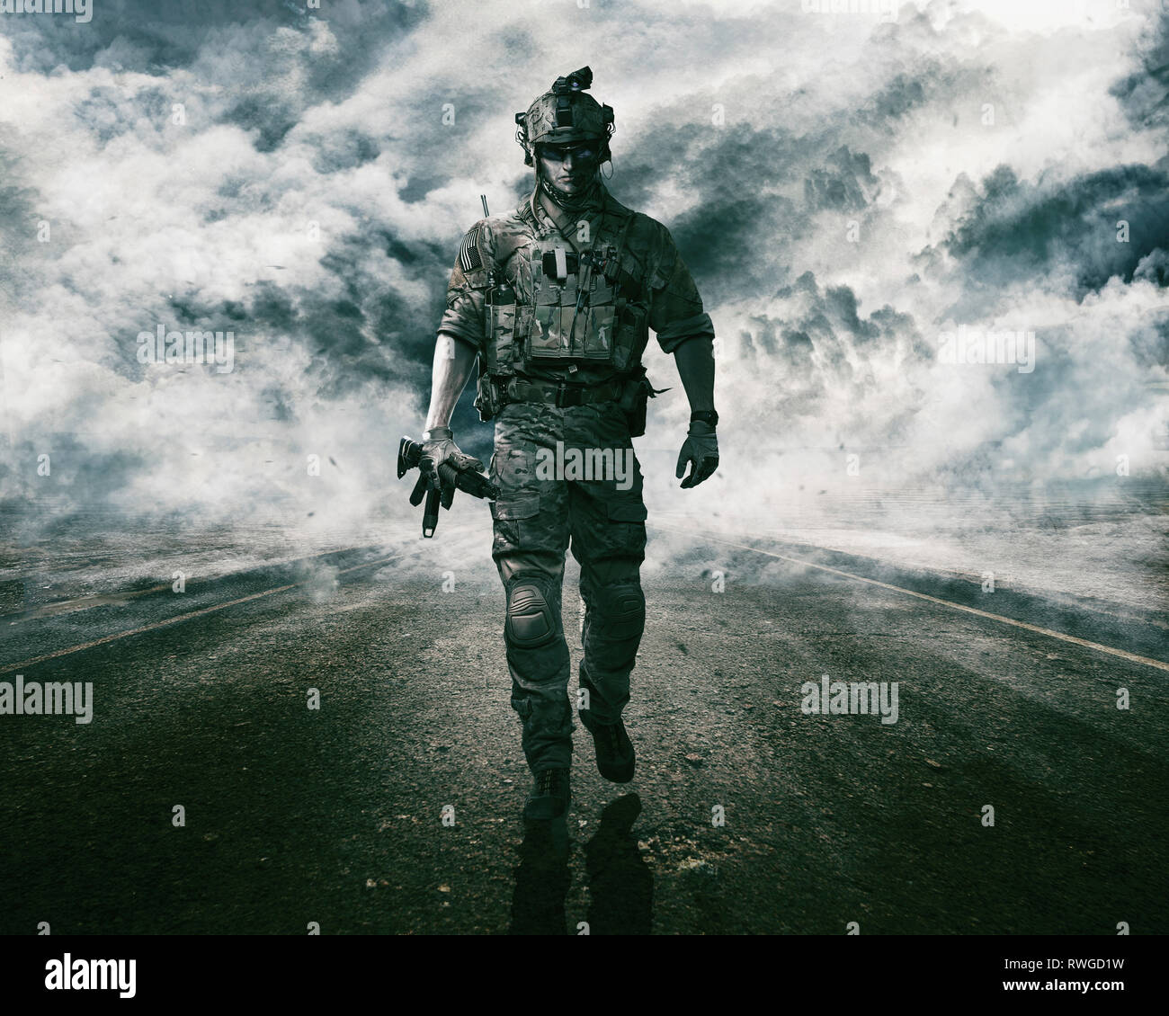 Army soldier moving towards camera on cloudscape background. - Stock Image