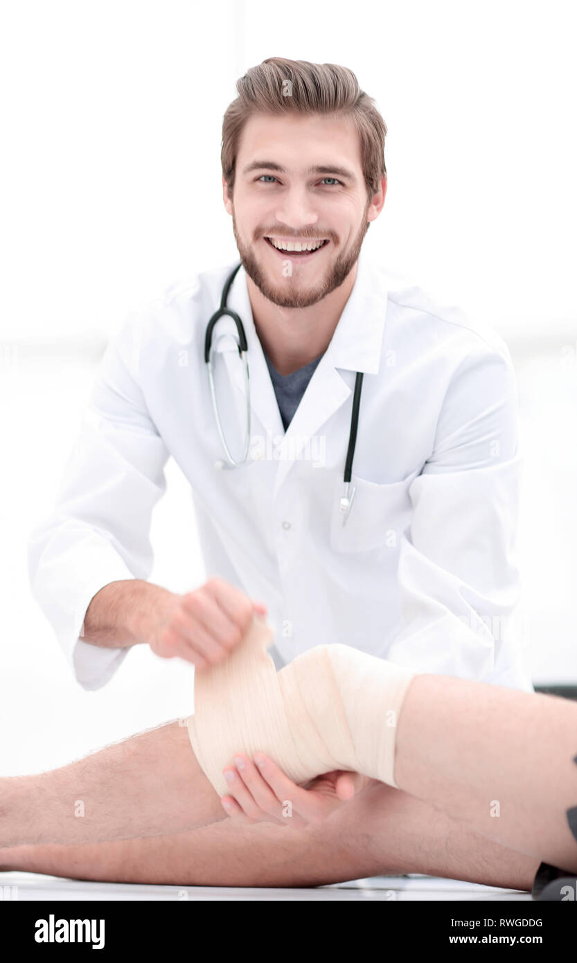 doctor rejoicing in the recovery of the patient. - Stock Image