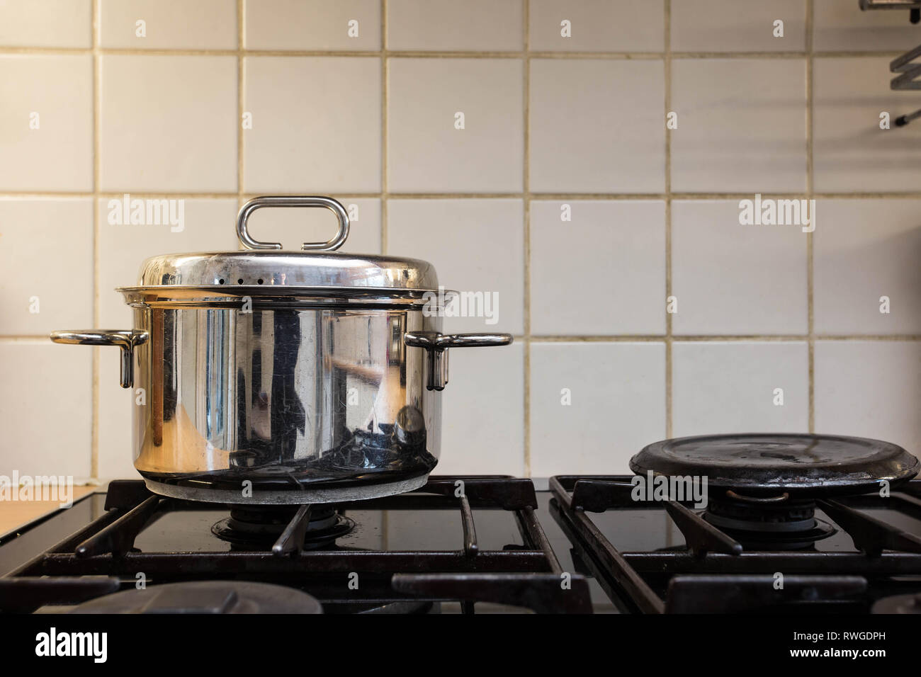 cooking pan on the gas stove, old design - Stock Image