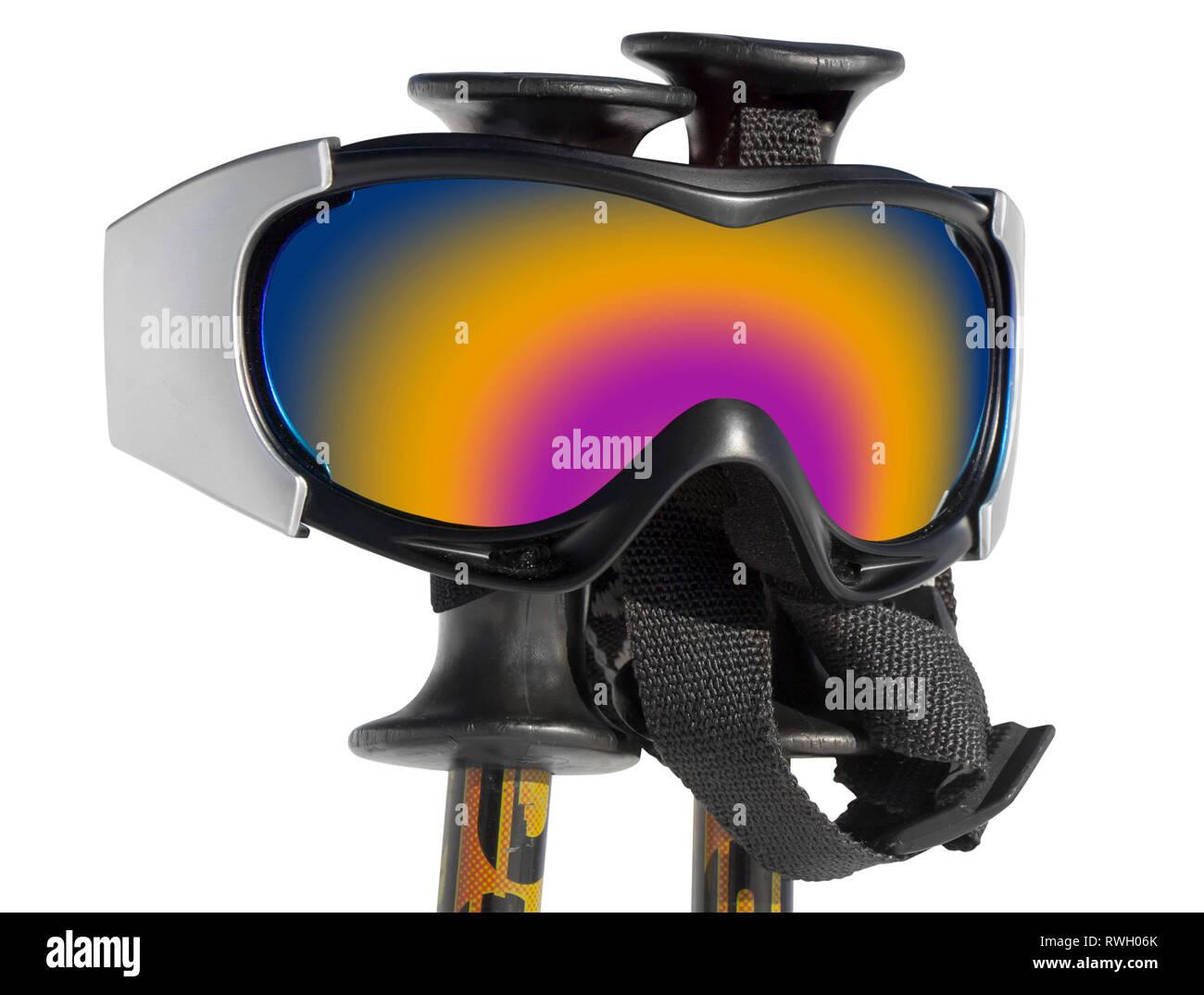Close up of the ski goggles on ski sticks isolated on white backgraund - Stock Image
