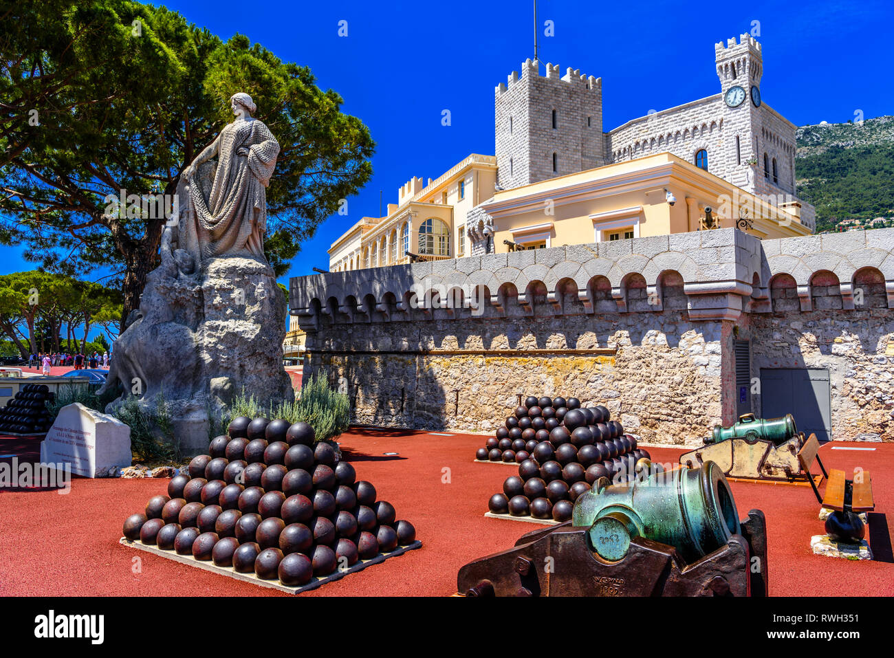 Sculpture tribute of foreign colonies with cannonballs and cannons in price's palace, Fontvielle, Monte-Carlo, Monaco, Cote d'Azur, French Riviera. - Stock Image