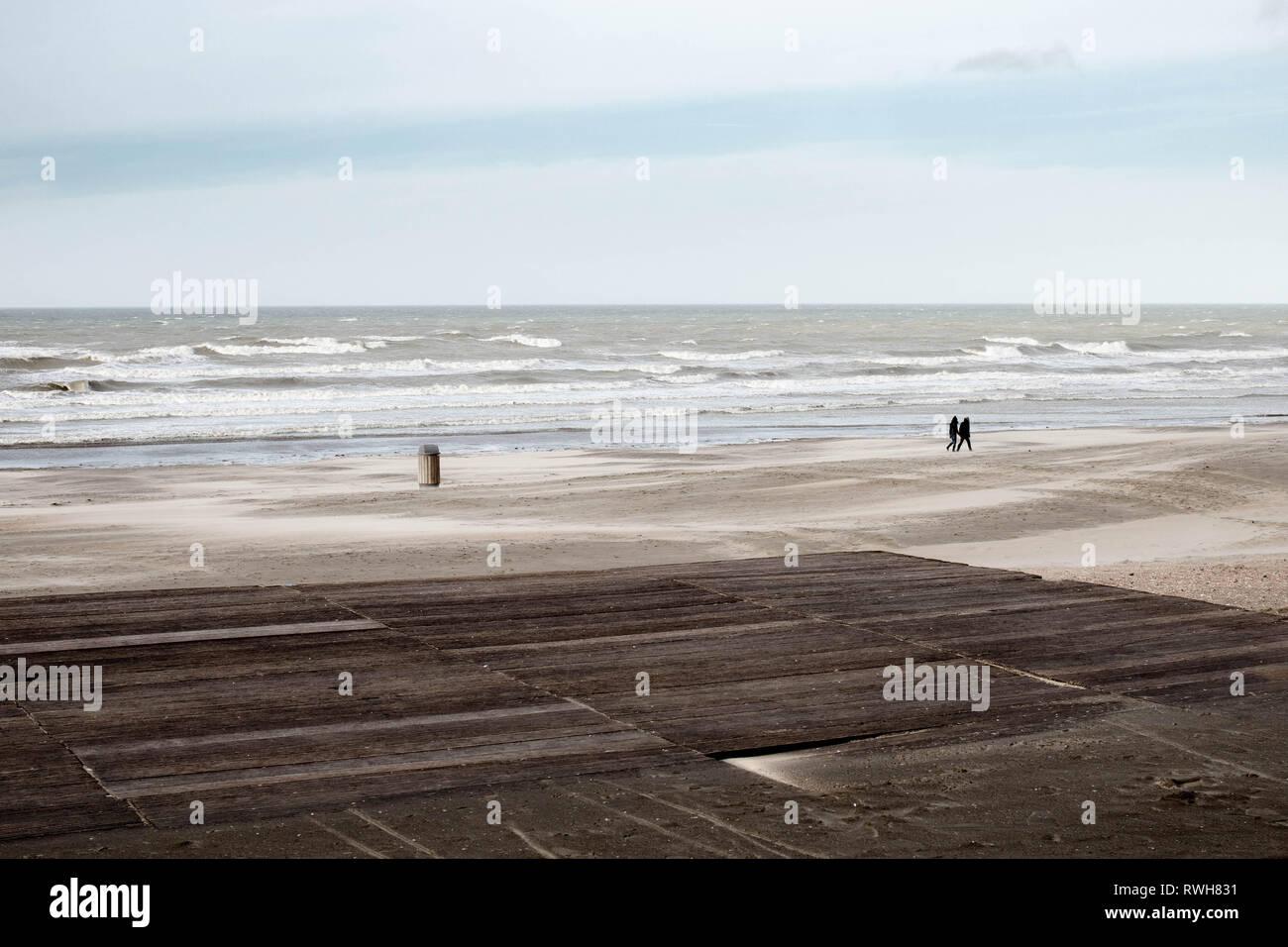 Nieuwpoort, Belgium - February 9, 2019 - People walking on the beach Stock Photo