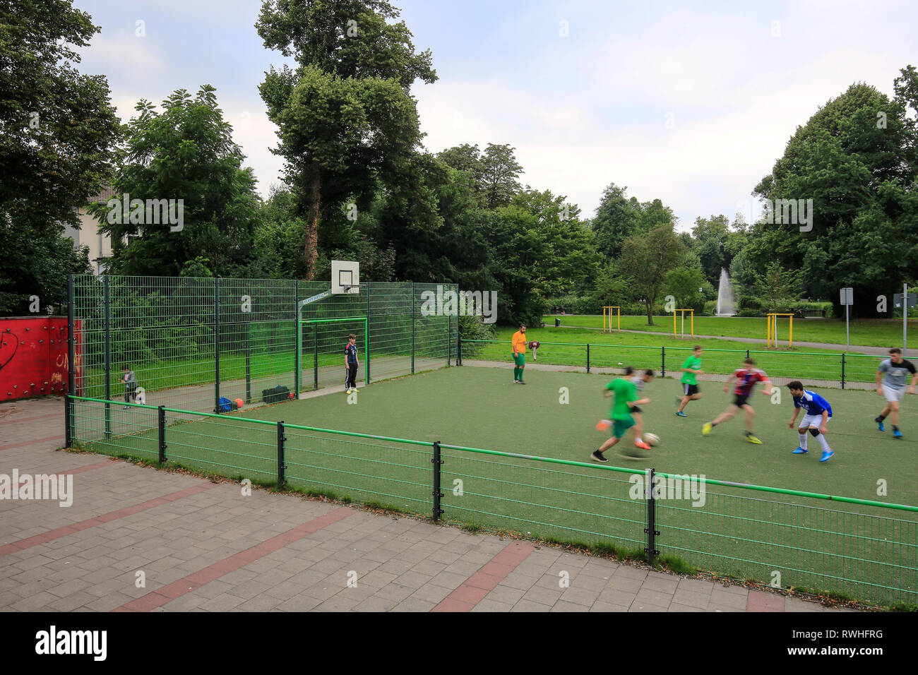 Essen, North Rhine-Westphalia, Ruhr area, Germany - young people play football on the football field in the Kaiser Wilhelm Park in Altenessen, here on - Stock Image