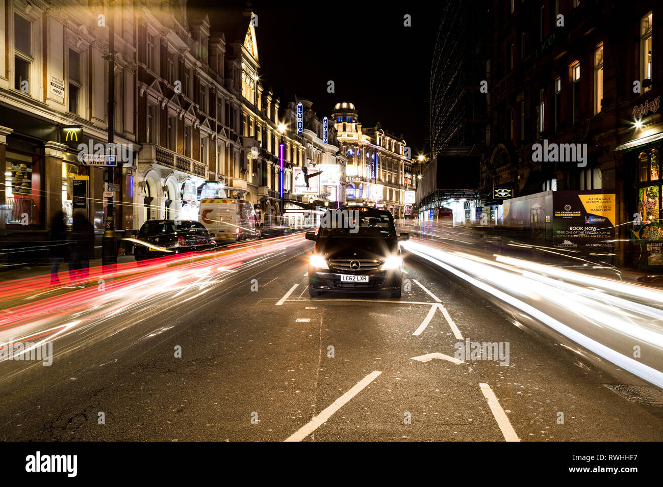 Light trail shot at Piccadilly Circus, London - Stock Image