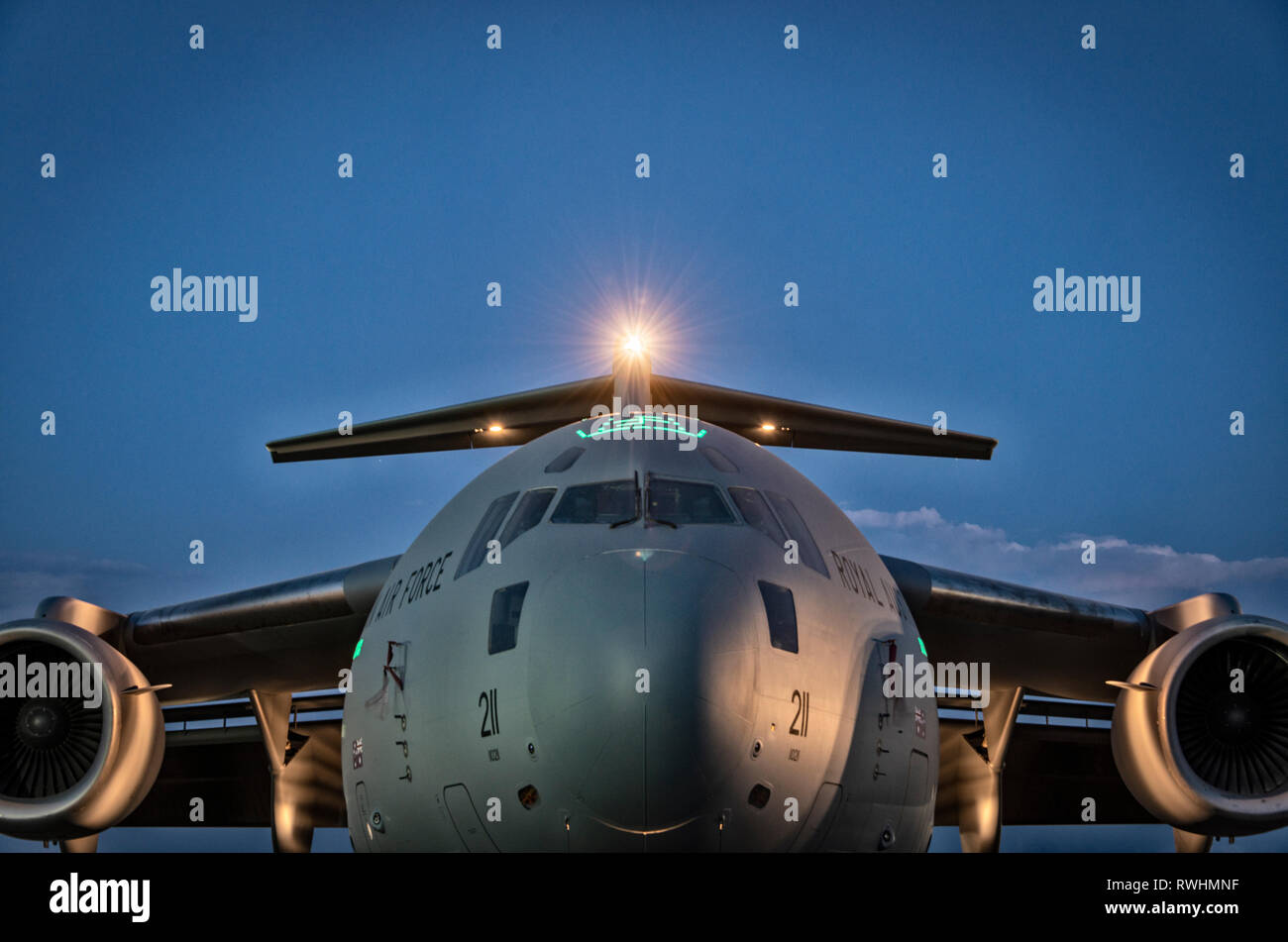 The front end of a Boeing C-17 Globemaster III at dusk - Stock Image