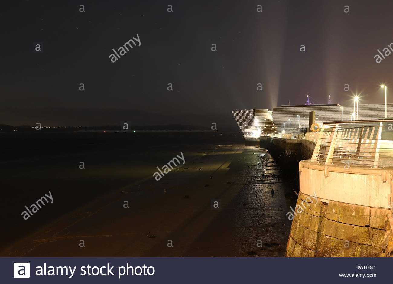 V&A Design Museum at a very low tide by night Dundee Scotland  February 2019 Stock Photo