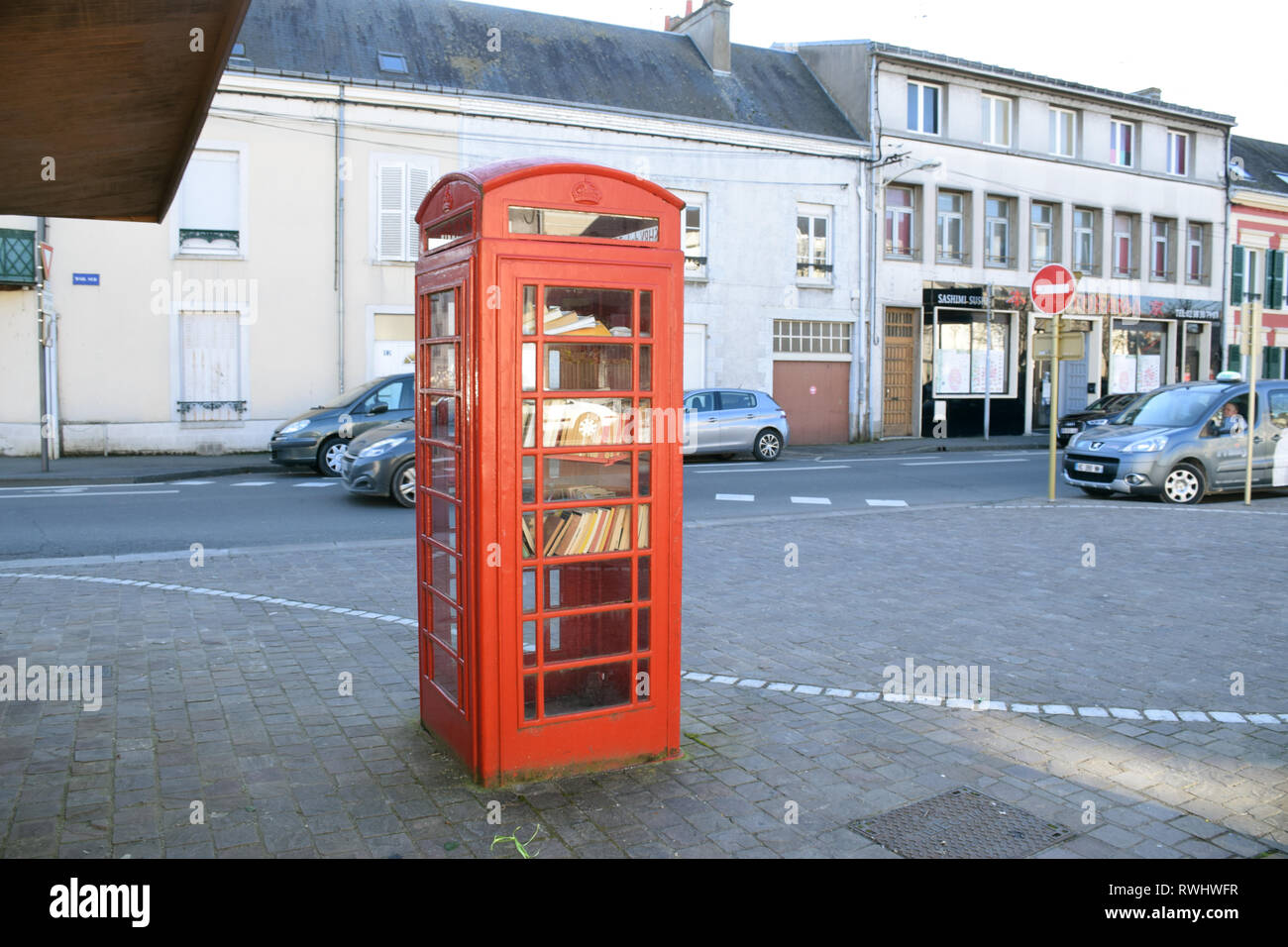Pithiviers in France is twinned with Ashby-de-la-Zouch in England. Donated red telephone box converted into a book swap library. Feb 2019 - Stock Image