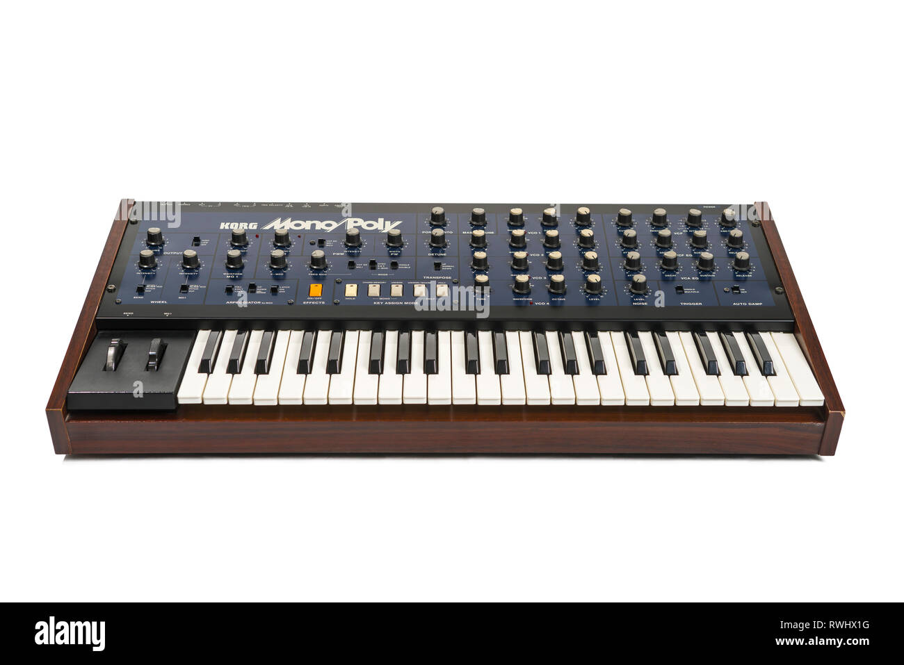 Korg Monopoly vintage analog synthesizer from 1981 and white studio background. - Stock Image