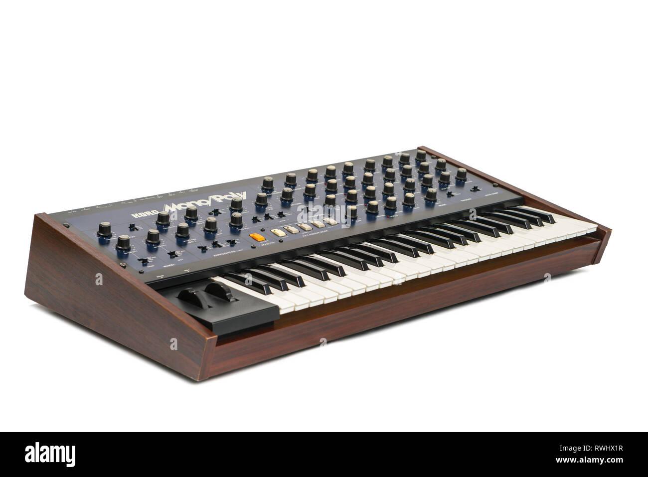 Korg Monopoly vintage analog synthesizer from 1981 and white studio background. - Stock Image