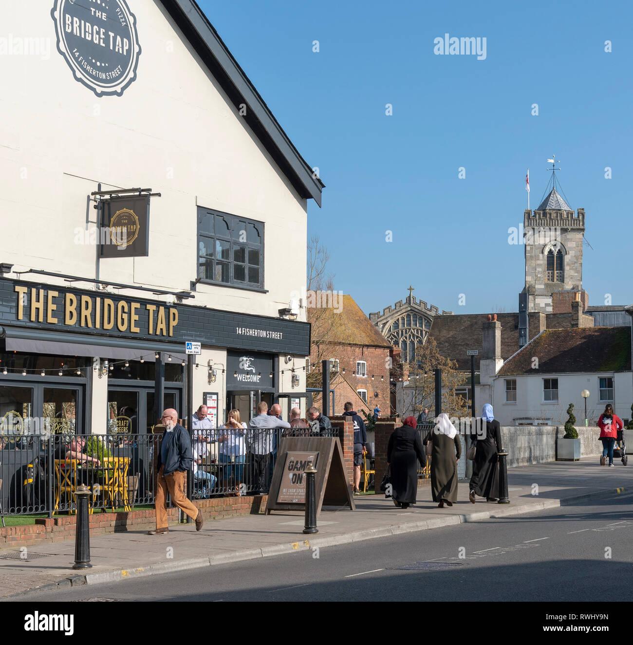 Salisbury, Wiltshire, England, UK. February 2019. The Bridge Tap pub on Fisherton Street in the city centre. Background of St Thomas's Church. - Stock Image