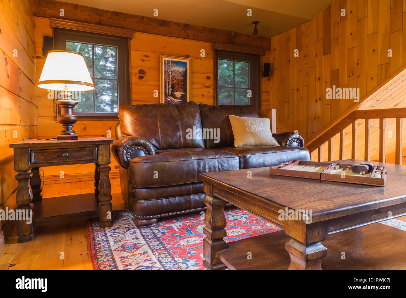 Brown Leather Sofa With Board Game On Top Of Wooden Coffee Table In The  Boudoir On The Mezzanine Inside A Milled Cottage Style Flat Log Profile  Home,