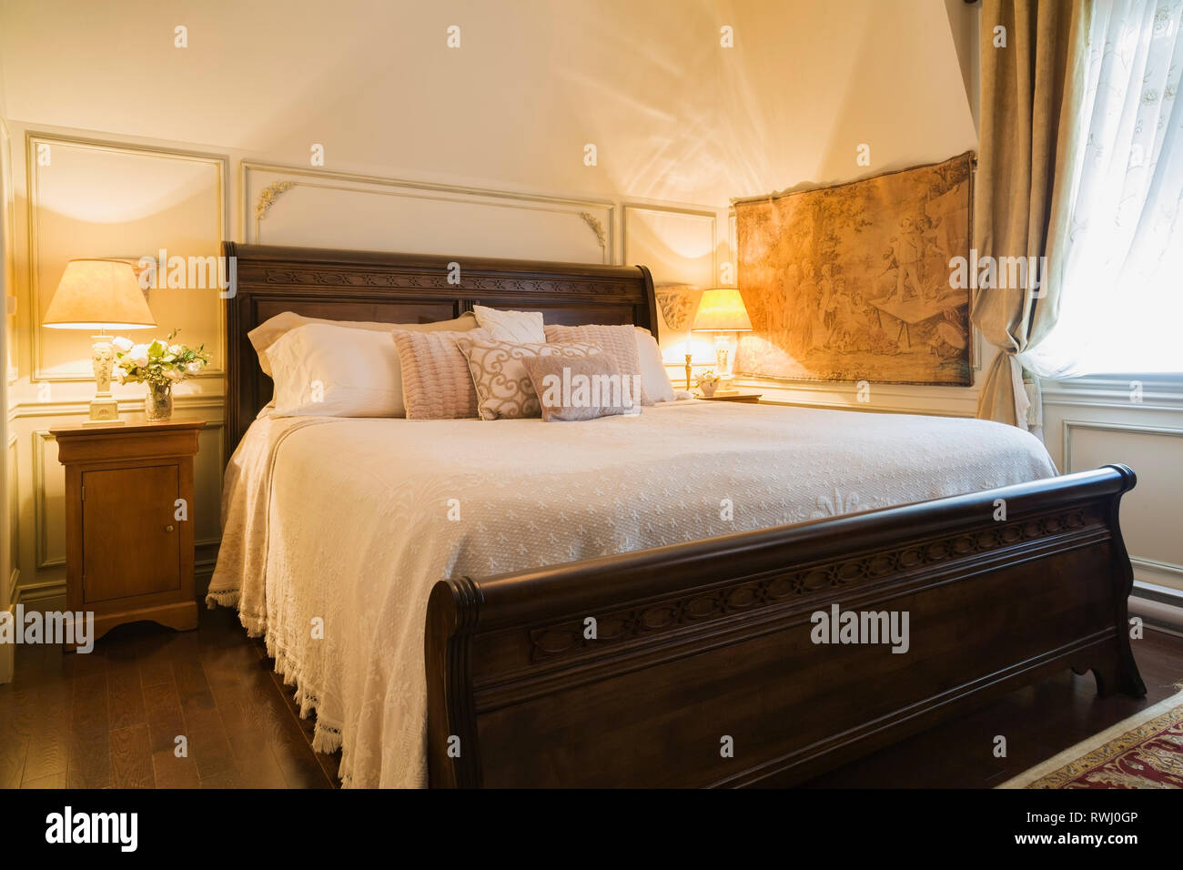 Amish Made King Size Bed With Wooden Headboard Footboard In The Master Bedroom On The Upstairs