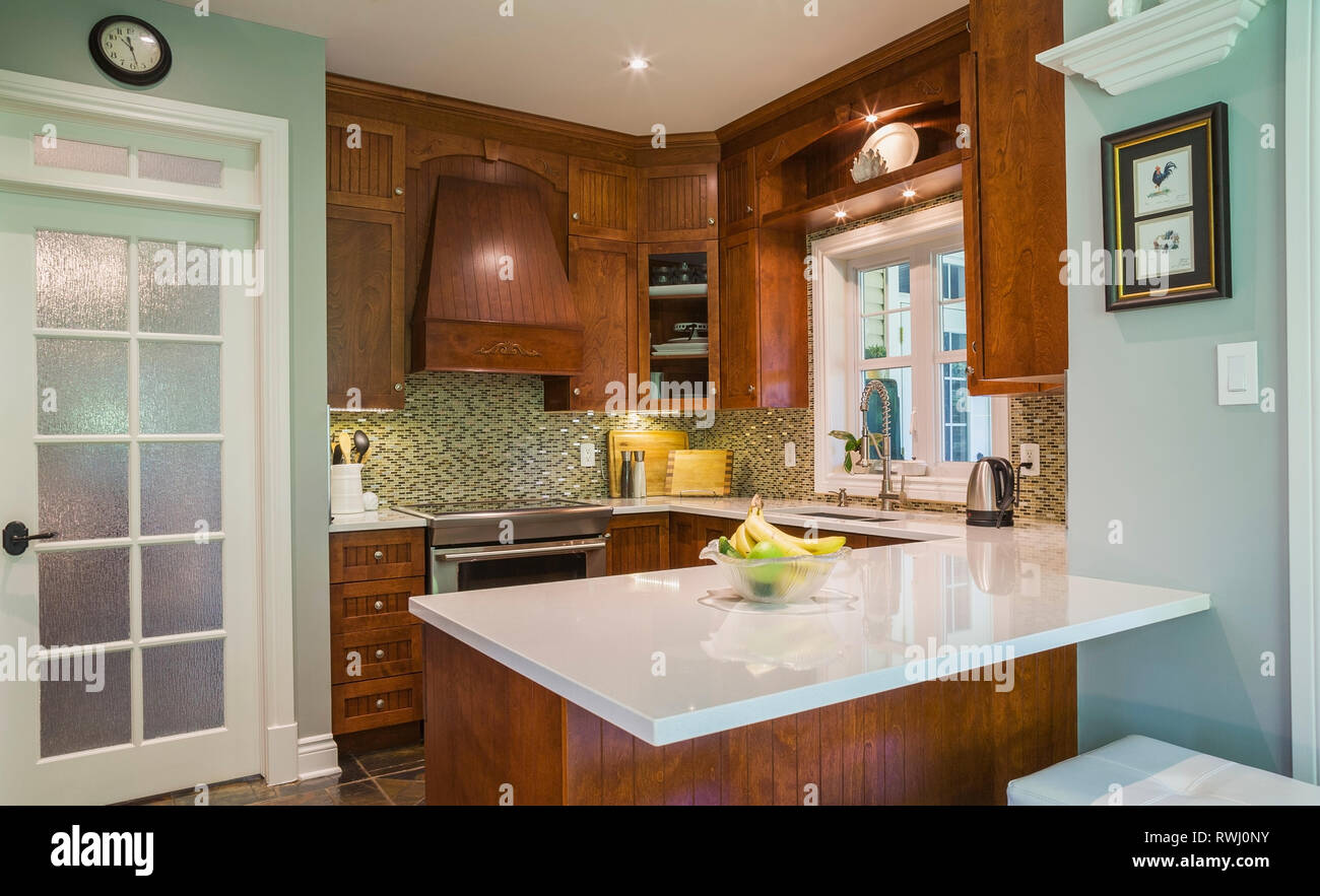 Kitchen With Earth Tone Slate Flooring Cherrywood Cabinets And