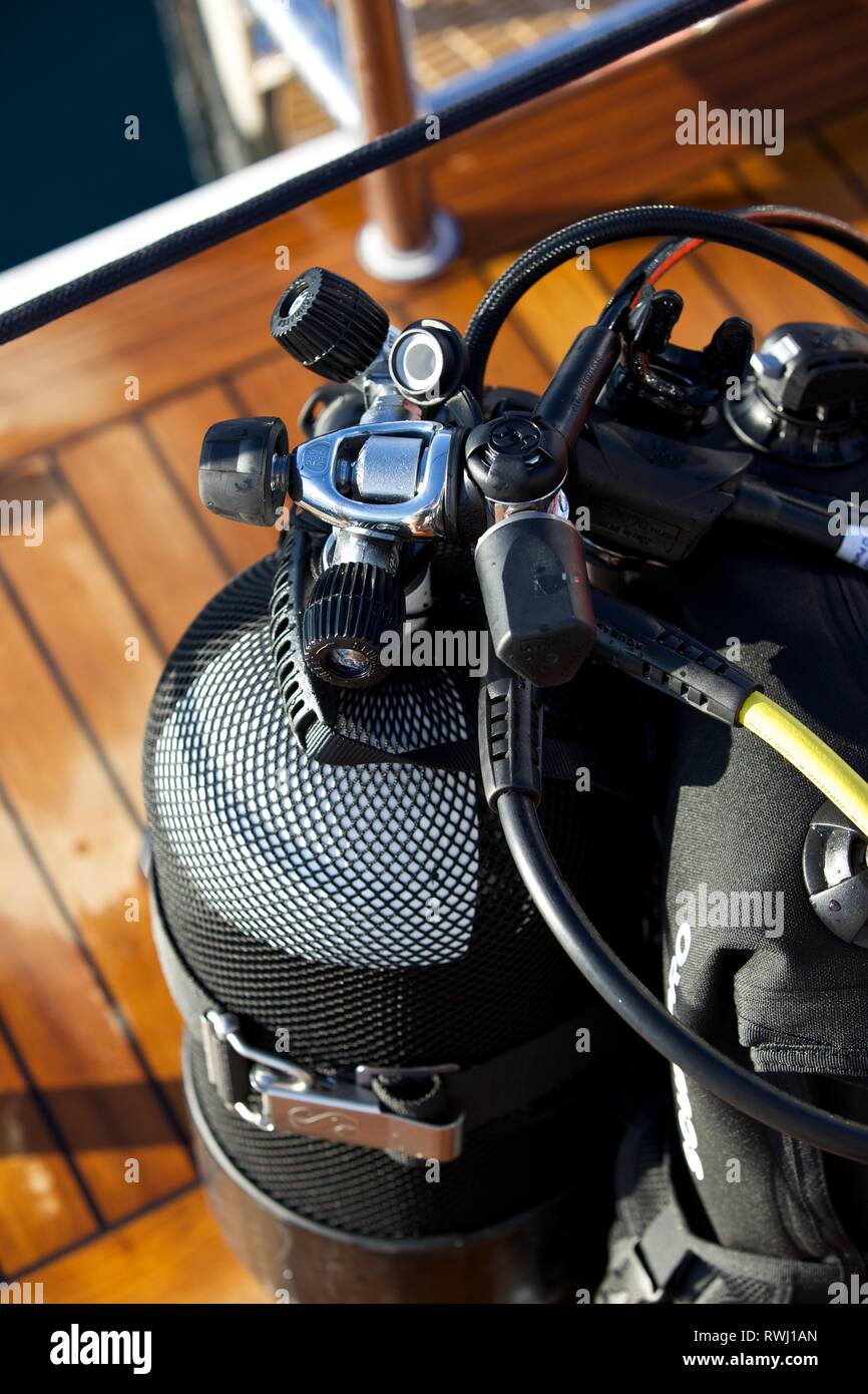 Close up of Diving equipment, Oxygen tank, Respirator on deck of boat - Stock Image