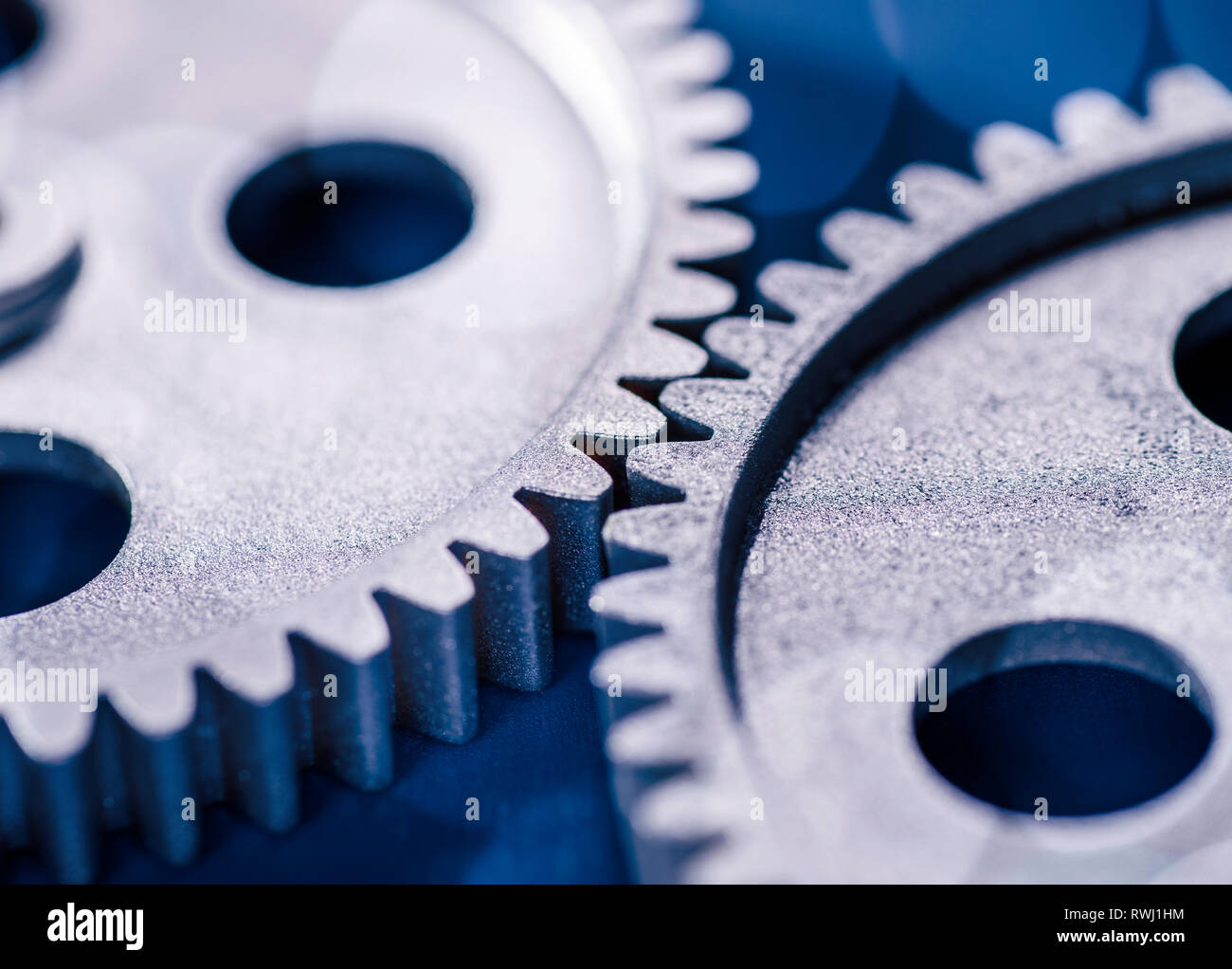 Detail of two gears meshing with each other. Stock Photo