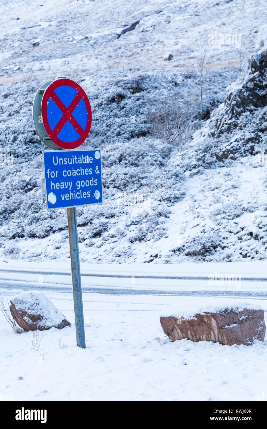 No stopping clearway & unsuitable for coaches and heavy goods vehicles road signs on A82 road on a cold winter day at Rannoch Moor, Argyll, Scotland - Stock Image