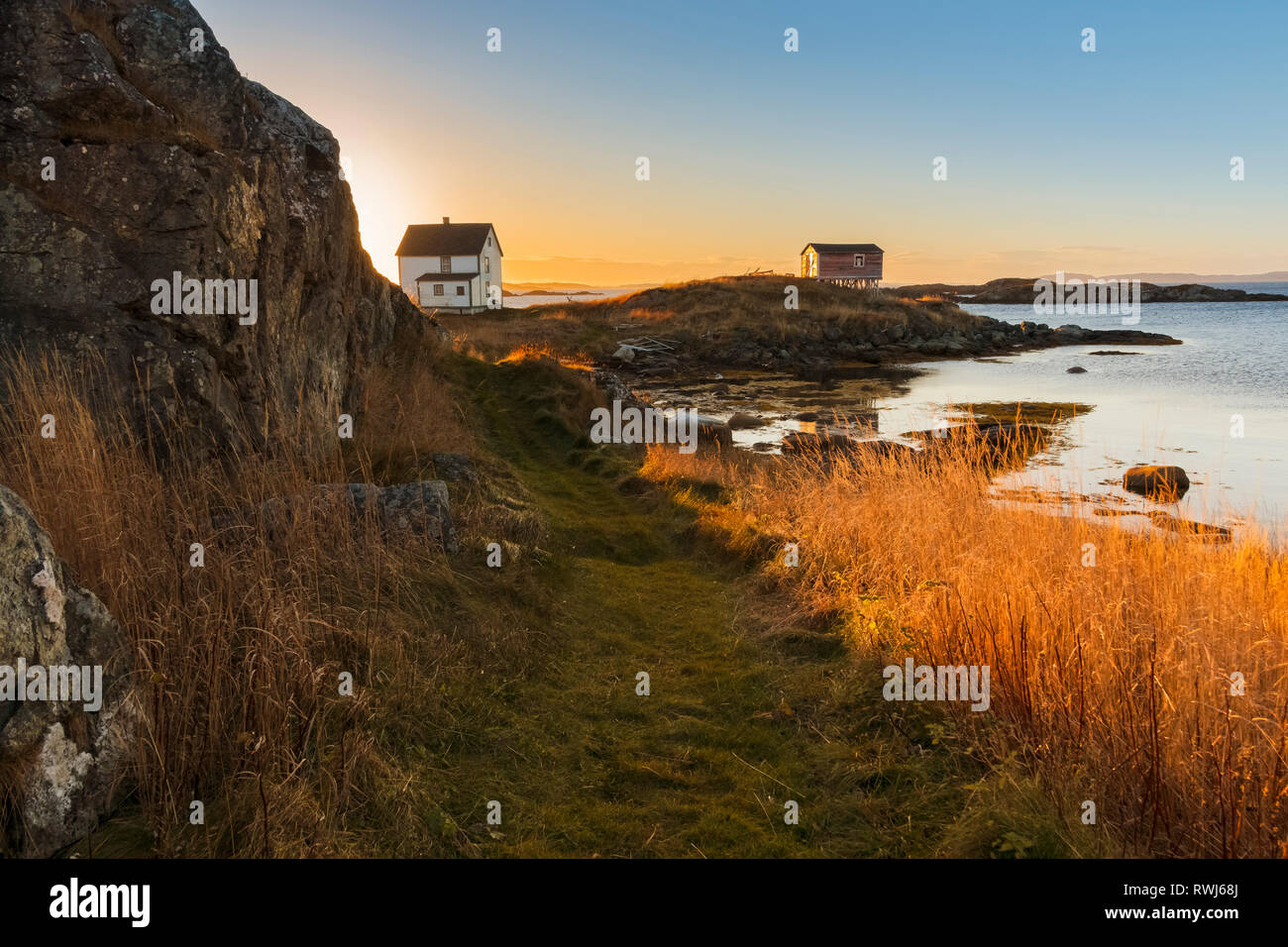 on looking sunset on the shores of Change Islands, during low tide, Newfoundland and Labrador Stock Photo