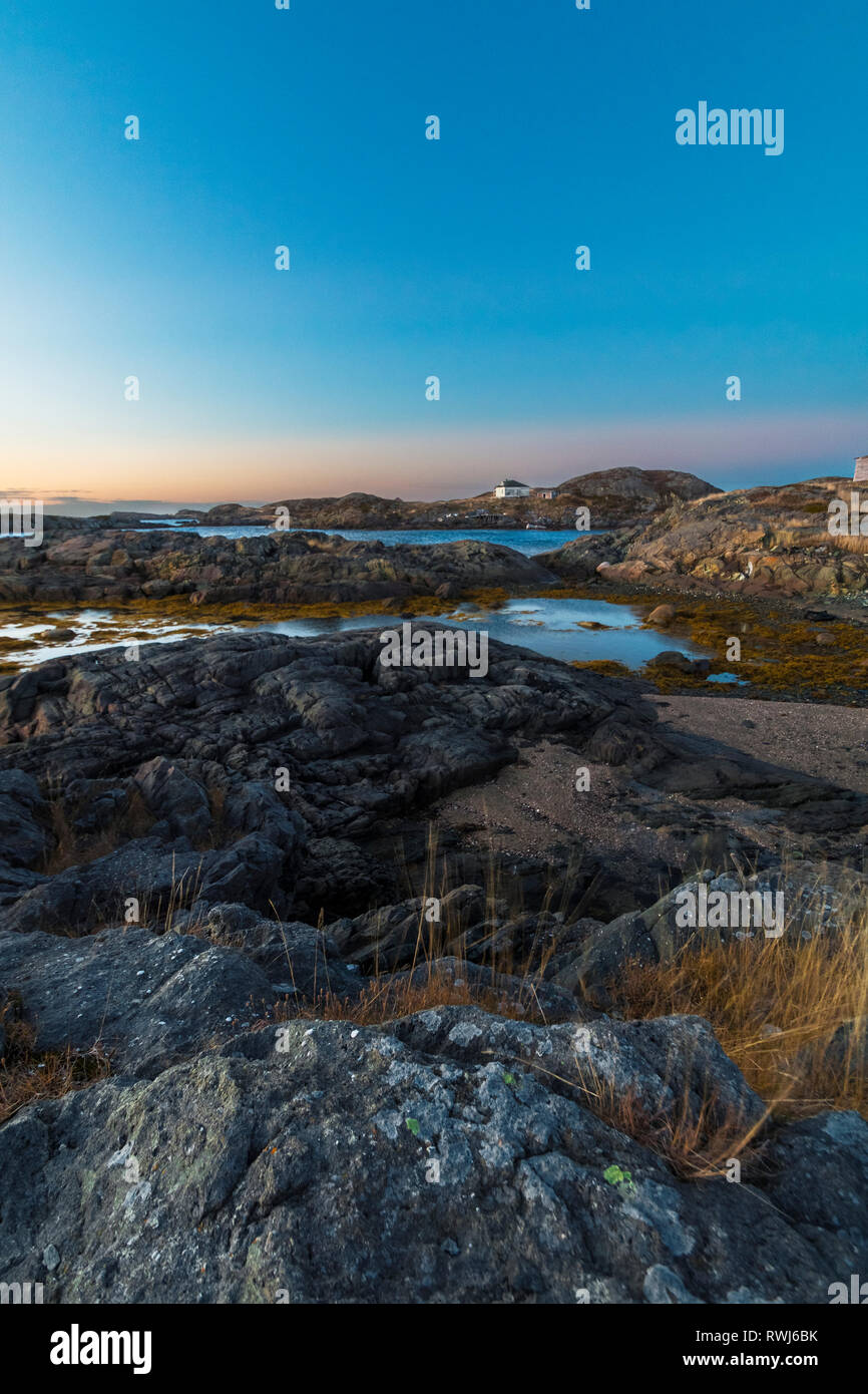 on looking sunset on the shores of Change Islands during low tide, Newfoundland and Labrador Stock Photo