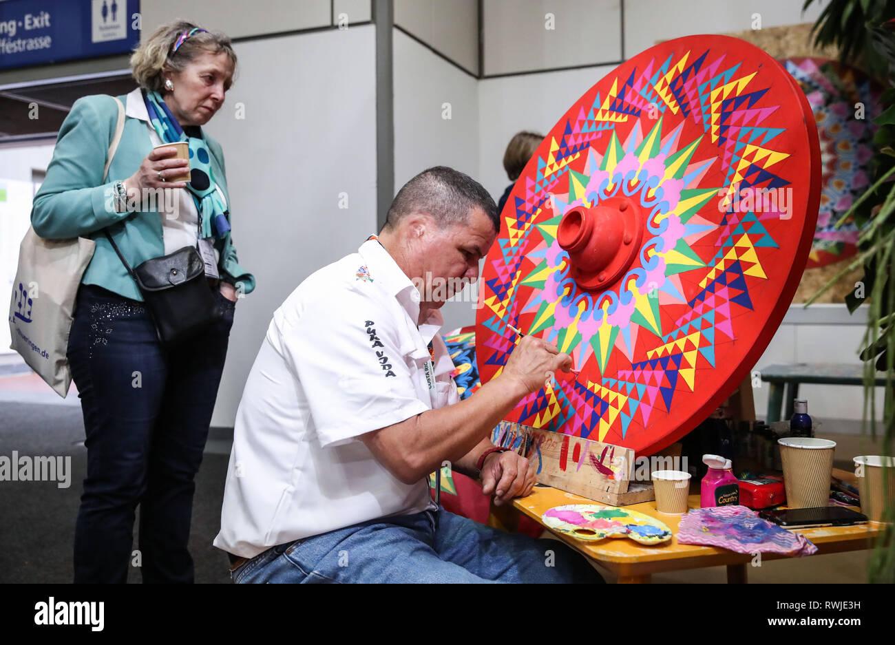 Berlin, Germany  6th Mar, 2019  A staff member paints an artware at