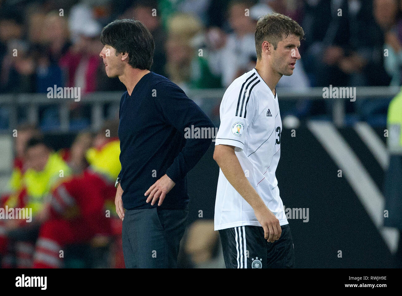 Hanover, Deutschland. 07th Mar, 2019. Federal coach Joachim Jogi LOEW, LOW (GER) and Thomas MUELLER. Stock Credit: Thomas MUELLER (re, MâA LLER) has been substituted by coach Joachim LOEW (LâA_W, both from GER), Football Laenderspiel, World Cup Qualification, Germany (GER) - Faeroeer (FRO) 3: 0, on 07.09.2012 in Hannover/Germany;   Usage worldwide/dpa/Alamy Live News - Stock Image