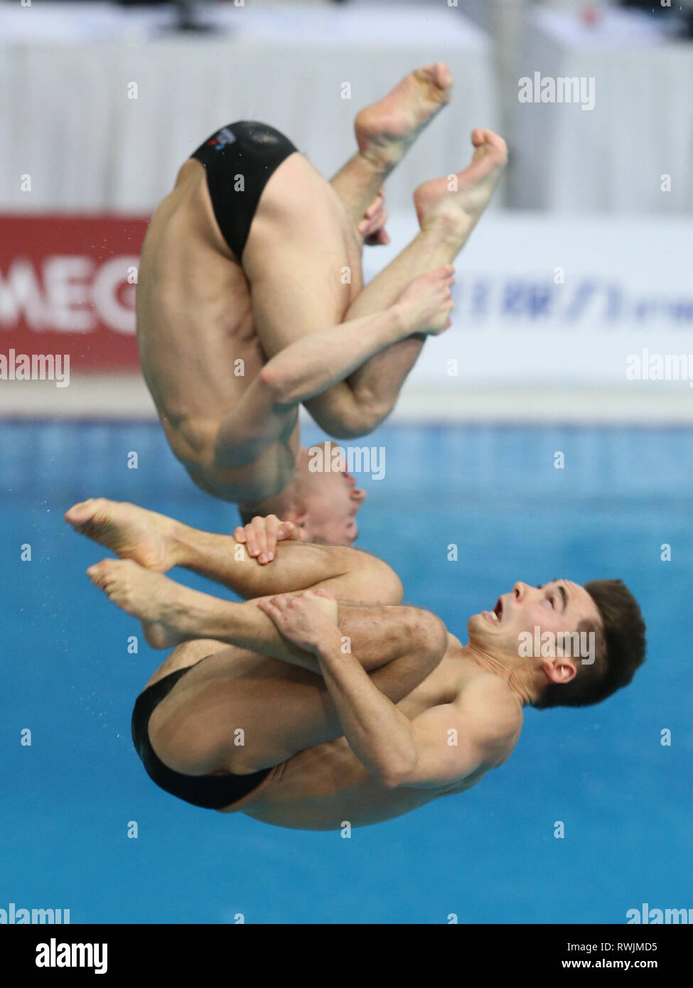 Beijing, China. 7th Mar, 2019. Jack Laugher (top)/Daniel Goodfellow of Britain compete during the men's 3m synchronised springboard final of the FINA Diving World Series 2019 at the National Aquatics Center in Beijing, capital of China, March 7, 2019. Credit: Xu Zijian/Xinhua/Alamy Live News - Stock Image
