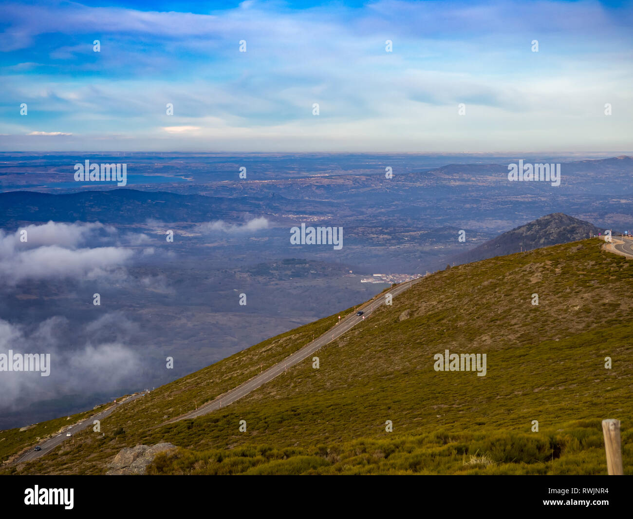 Aerial view of mountain landscape with a road and cloudy sky on a winter day on La Covatilla, Bejar (Salamanca) - Stock Image