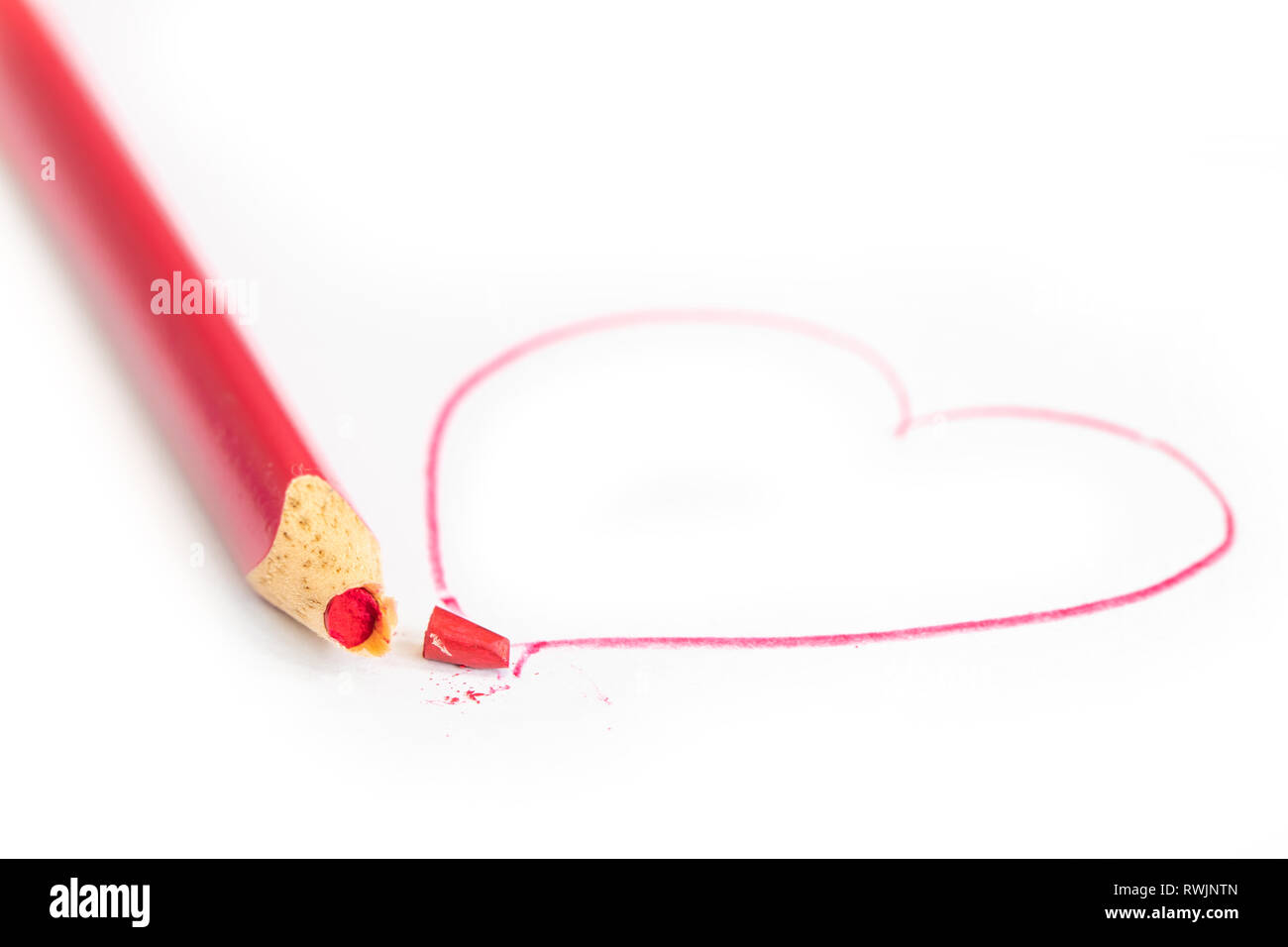 broken heart red crayon broke divorce parting end of love - Stock Image
