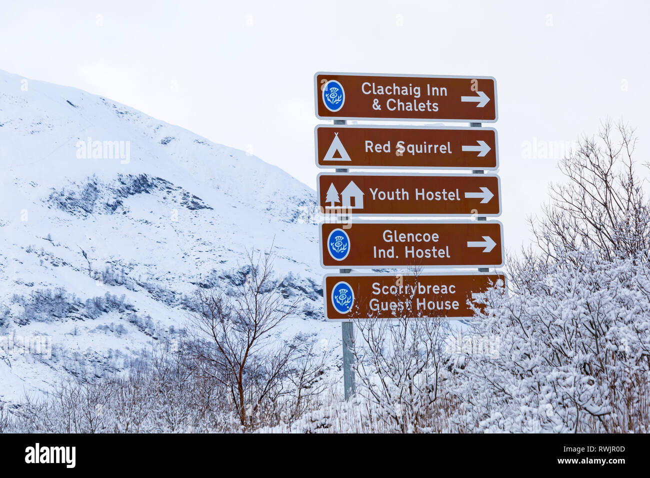Directions road signs in Glencoe on a cold winter day with snow at Rannoch Moor, Glencoe, Argyll, Scotland - Stock Image