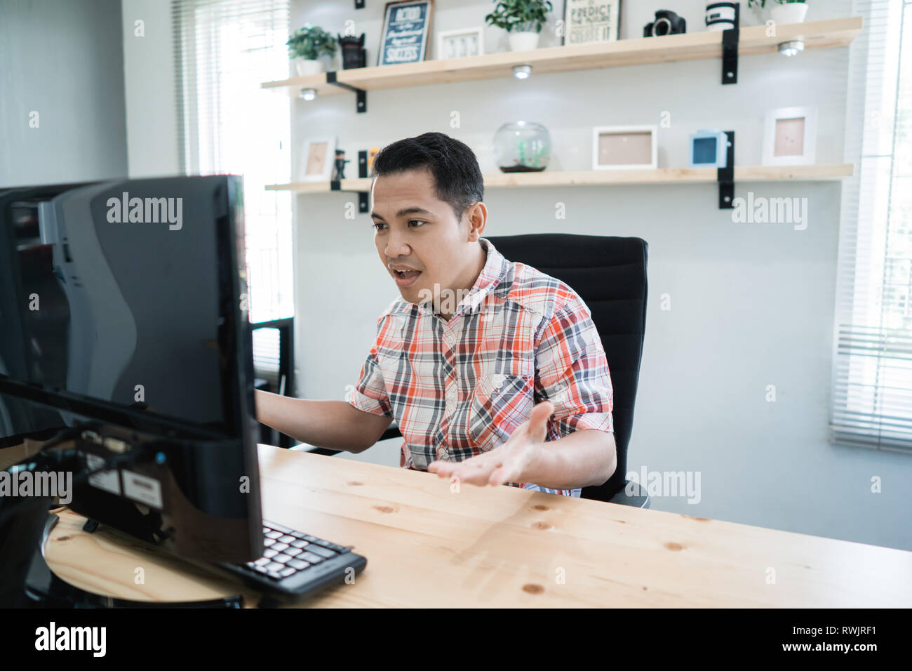 disappointed man at his office - Stock Image