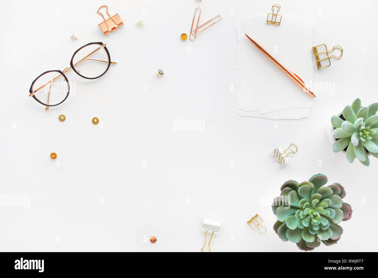 Elegant work table with business accessories on withe background.luxury feminism style.flat lay - Stock Image