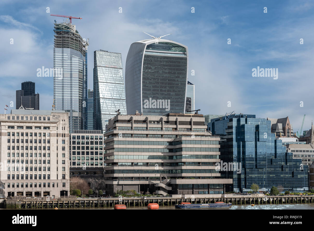 Walkie-talkie, Cheesegrater loom over the low rise buildings of Lower Thames St. - Stock Image