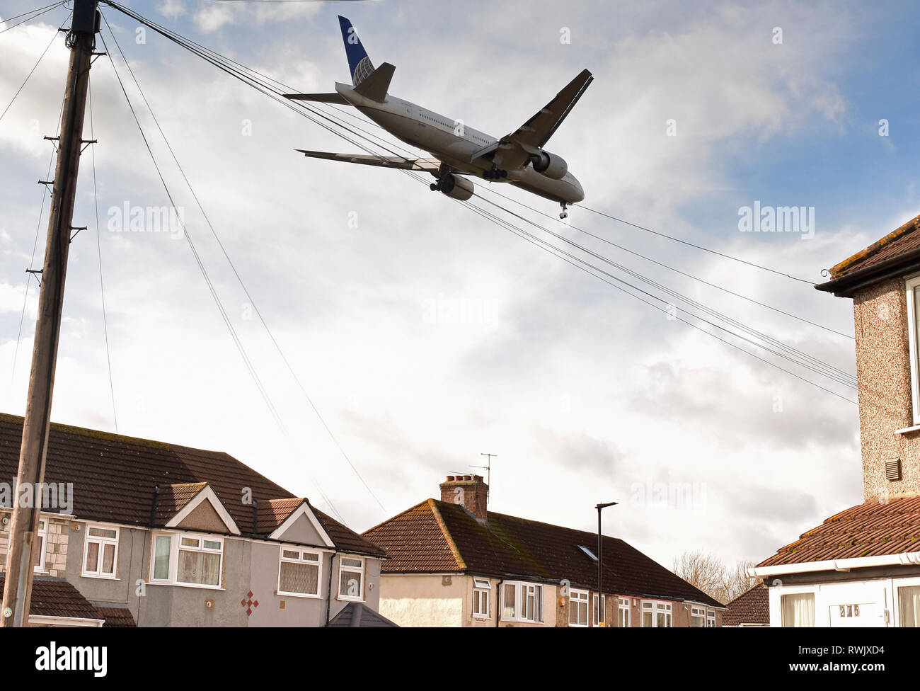 Low Flying Aircraft Landing at Heathrow Airport, London over Houses - Stock Image