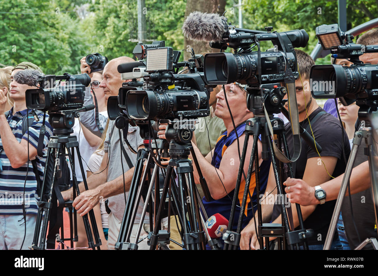 Dnipro, Ukraine - June 27, 2018: TV operators and photographers are reporting from the opening of inclusive city park in the of Dnipro city - Stock Image