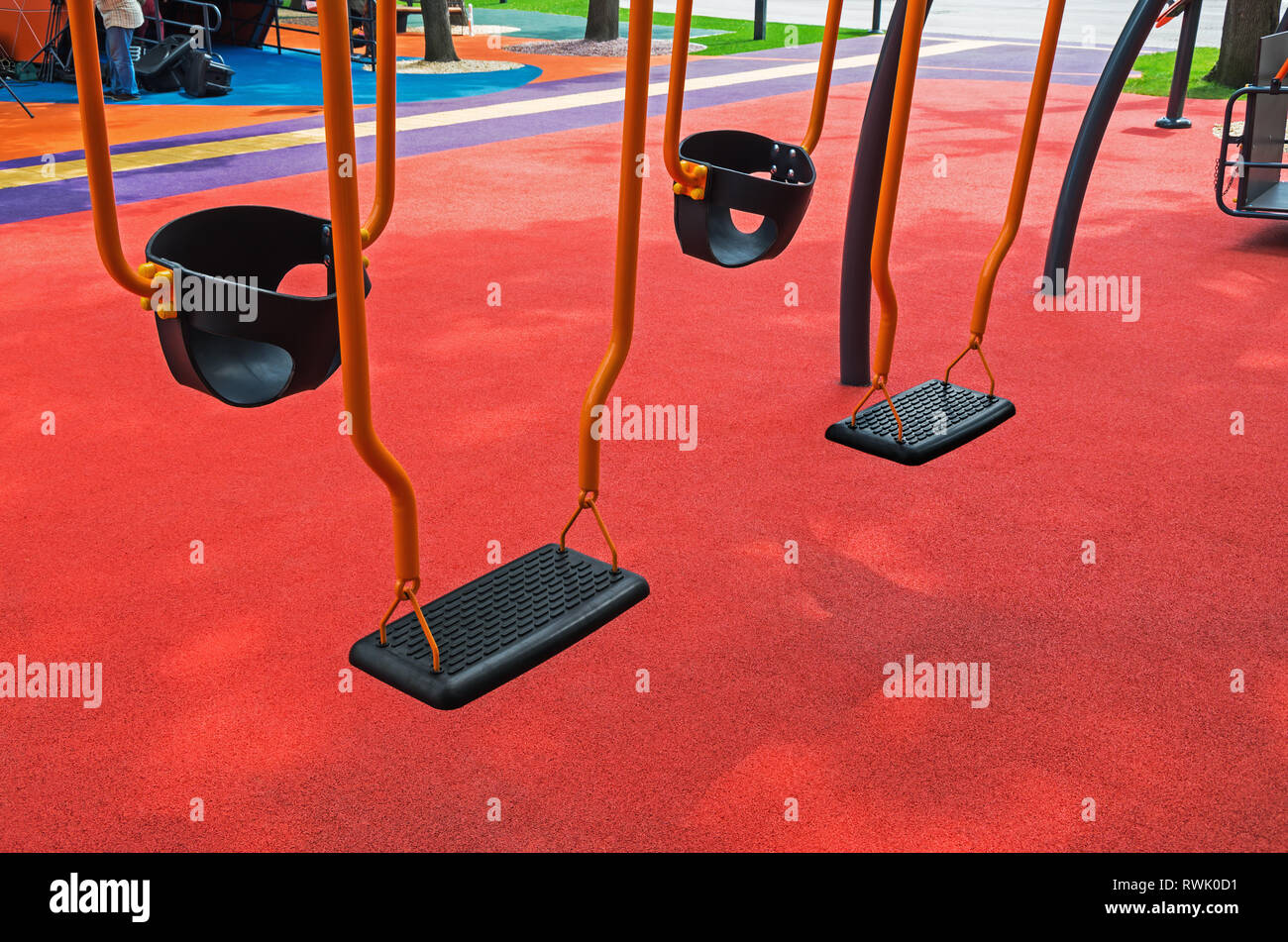 New swings for children with special needs on which you can swing parents and children at the same time - Stock Image