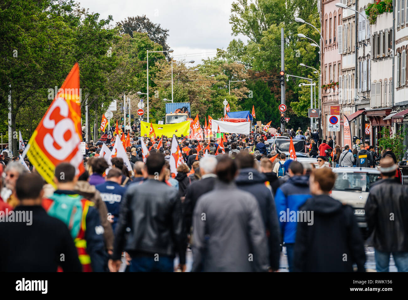 Strasbourg, France - Sep 12, 2017: Rear view of thousands of people on Quai des Pecheurs street political march during a French Nationwide day of protest against the labor reforms - Stock Image