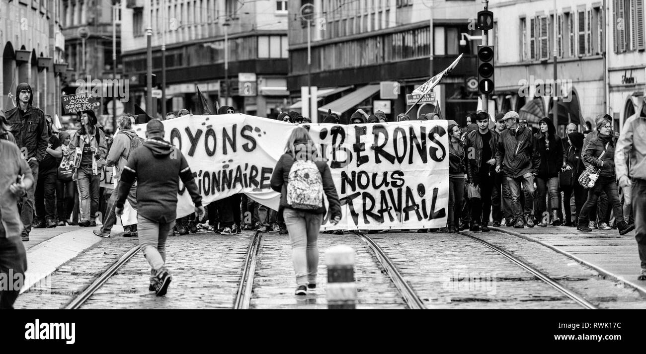 Strasbourg, France - Sep 12, 2017: let's be revolutionary message on placard at political march during a French Nationwide day of protest against the labor reforms - black and white - Stock Image