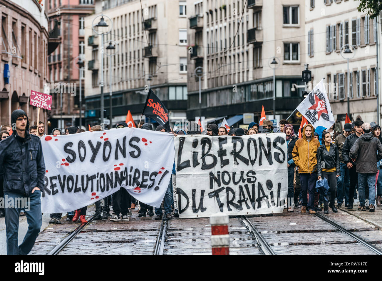Strasbourg, France - Sep 12, 2017: let's be revolutionary message on placard at political march during a French Nationwide day of protest against the labor reforms - thousands of people on street - Stock Image
