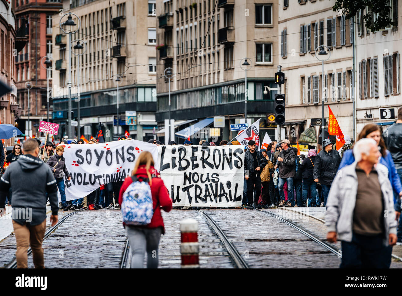 Strasbourg, France - Sep 12, 2017: let's be revolutionary message on placard at political march during a French Nationwide day of protest against the labor reforms - Stock Image